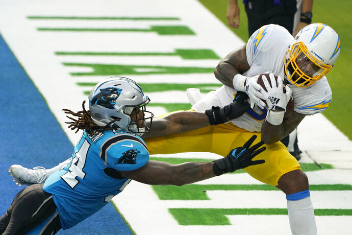 Los Angeles Chargers wide receiver Keenan Allen, right, makes a touchdown catch next to Carolina Panthers outside linebacker Shaq Thompson during the second half of an NFL football game Sunday, Sept. 27, 2020, in Inglewood, Calif. (AP Photo/Alex Gallardo)