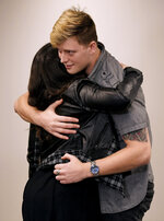 Carverton publicist Jen Apple hugs band member Michael Wiebel after a press conference about the killing of fellow member Kyle Yorlets at Belmont University in Nashville on Monday, Feb. 11, 2019. Yorlets, the frontman for the rock band Carverton was gunned down during a robbery Thursday, Feb. 7. Police have charged five juveniles in the case. A memorial service was scheduled to follow.  (Shelley Mays/The Tennessean via AP)