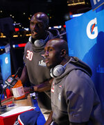 New England Patriots' Jason McCourty and Devin McCourty answer questions during Opening Night for the NFL Super Bowl 53 football game Monday, Jan. 28, 2019, in Atlanta. (AP Photo/David Goldman)