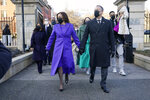 Vice President Kamala Harris, and her husband Doug Emhoff, and family, walk near the White House during a Presidential Escort to the White House, Wednesday, Jan. 20, 2021 in Washington, after being sworn in as the 46th vice president of the United States. (AP Photo/Jacquelyn Martin)