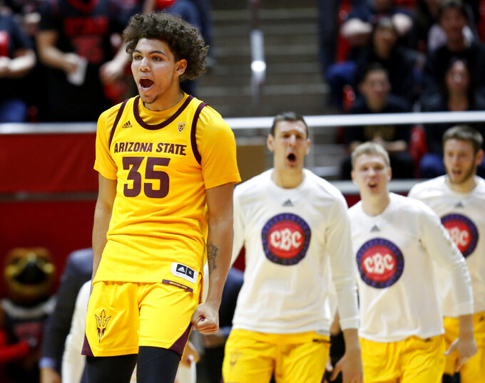 Arizona State's Taeshon Cherry celebrates his team's lead in the first half of an NCAA college basketball game against Utah on Saturday, Feb. 16, 2019, in Salt Lake City. (AP Photo/Kim Raff)