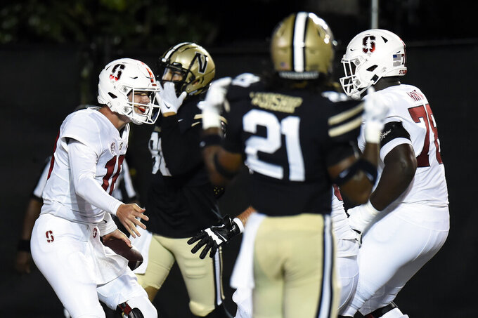 Stanford quarterback Tanner McKee, left, celebrates after running the ball into the end zone for a touchdown against Vanderbilt in the first half of an NCAA college football game Saturday, Sept. 18, 2021, in Nashville, Tenn. (AP Photo/Mark Zaleski)