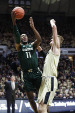 Michigan State forward Aaron Henry (11) shoots over Purdue center Matt Haarms (32) during the first half of an NCAA college basketball game in West Lafayette, Ind., Sunday, Jan. 27, 2019. (AP Photo/Michael Conroy)
