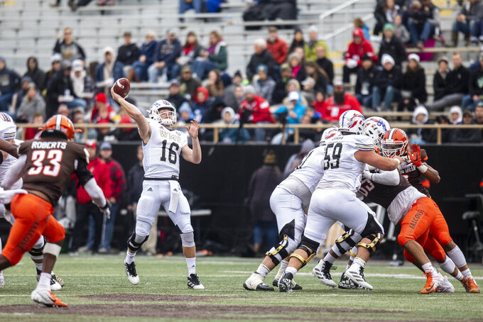 Western Michigan Broncos quarterback Jon Wassink (16) attempts a pass against Bowling Green Falcons during the second quarter of an NCAA college football game in Kalamazoo, Mich., on Saturday, Oct. 26, 2019. (Joel Bissell/Kalamazoo Gazette via AP)