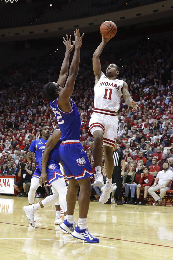 Indiana's Devonte Green (11) shoots over Louisiana Tech's Isaiah Crawford (22) during the first half of an NCAA college basketball game, Monday, Nov. 25, 2019, in Bloomington, Ind. (AP Photo/Darron Cummings)