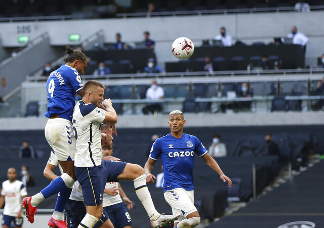 Everton's Dominic Calvert-Lewin, top, scores his side's opening goal during the English Premier League soccer match between Tottenham Hotspur and Everton at the Tottenham Hotspur Stadium in London, Sunday, Sept. 13, 2020. (Alex Pantling/Pool via AP)
