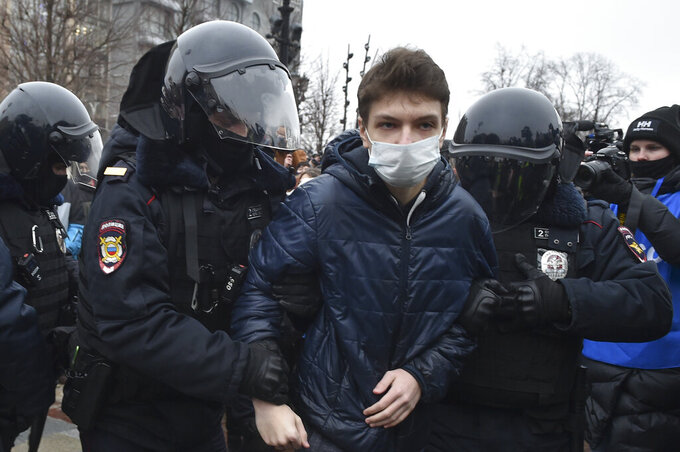 Police detain a man during a protest against the jailing of opposition leader Alexei Navalny in Moscow, Russia, Saturday, Jan. 23, 2021. Russian police on Saturday arrested hundreds of protesters who took to the streets in temperatures as low as minus-50 C (minus-58 F) to demand the release of Alexei Navalny, the country's top opposition figure.  Navalny, President Vladimir Putin's most prominent foe, was arrested on Jan. 17 when he returned to Moscow from Germany, where he had spent five months recovering from a severe nerve-agent poisoning that he blames on the Kremlin. (AP Photo/Dmitry Serebryakov)