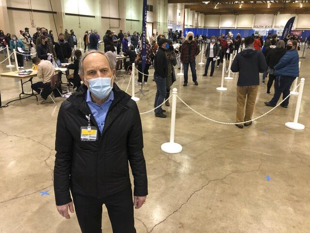 Dr. Ralph Yates, chief medical officer for Salem Health Hospital and regional care system in Oregon, poses for a photo on Friday, Jan. 8, 2021, at the Oregon State Fairgrounds, in Salem, Ore. where hospital personnel is giving COVID-19 vaccinations to a priority group of health care workers. They gave about 1,700 doses the previous day and expect to give around the same number on Friday. The Oregon National Guard will assist in the coming days. (AP Photo/Andrew Selsky)