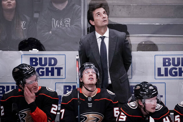 Anaheim Ducks coach Dallas Eakins watches during the third period of an NHL hockey game against the New Jersey Devils in Anaheim, Calif., Sunday, March 1, 2020. (AP Photo/Chris Carlson)