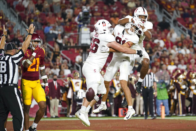 Stanford wide receiver Brycen Tremayne, center, celebrates his touchdown catch with guard Branson Bragg, left, and wide receiver Elijah Higgins during the first half of the team's NCAA college football game against Southern California on Saturday, Sept. 11, 2021, in Los Angeles. (AP Photo/Marcio Jose Sanchez)