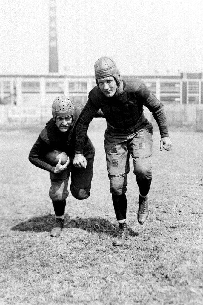 FILE - This is a Sept. 13, 1930, file photo showing Chicago Bears professional football players Red Grange, left, and Bronko Nagurski.  Nagurski was a powerful and dominant fullback who began his career with the Bears in 1930 and played nine seasons with Chicago. He was one of nine players in the 1930s to be inducted in the first Pro Football Hall of Fame class in 1963, joining Red Grange, Don Hutson, Johnny Blood, Ernie Nevers, Cal Hubbard, Mel Hein, Dutch Clark and Sammy Baugh. (AP Photo/File)