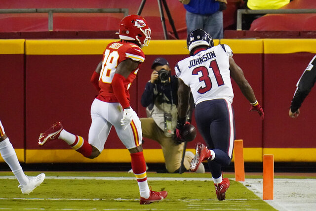 Houston Texans running back David Johnson (31) beats Kansas City Chiefs safety L'Jarius Sneed (38) to the end zone as Johnson scores a touchdown in the first half of an NFL football game Thursday, Sept. 10, 2020, in Kansas City, Mo. (AP Photo/Jeff Roberson)