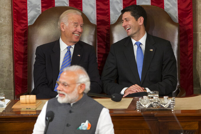 FILE- In this June 8, 2016 file photo, then Vice President Joe Biden and then House Speaker Paul Ryan of Wis., laugh as Indian Prime Minister Narendra Modi addresses a joint meeting of Congress on Capitol Hill in Washington. As Americans celebrate or fume over the new U.S. president-elect, many in Asia are waking up to the reality of a Joe Biden administration with decidedly mixed feelings. Relief and hopes of economic and environmental revival jostle with needling anxiety and fears of inattention. Not much will change with the host of security and defense ties shared by India and the United States. But a Biden administration could mean a much closer look at India's spotty recent human rights and religious freedom records, both of which were largely ignored by U.S. President Donald Trump. (AP Photo/Evan Vucci, File)