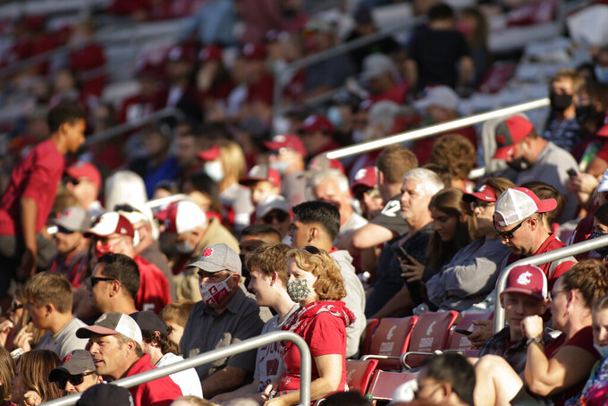 Fans watch the start of the second half of an NCAA college football game between Washington State and Portland State, Saturday, Sept. 11, 2021, in Pullman, Wash. (AP Photo/Young Kwak)