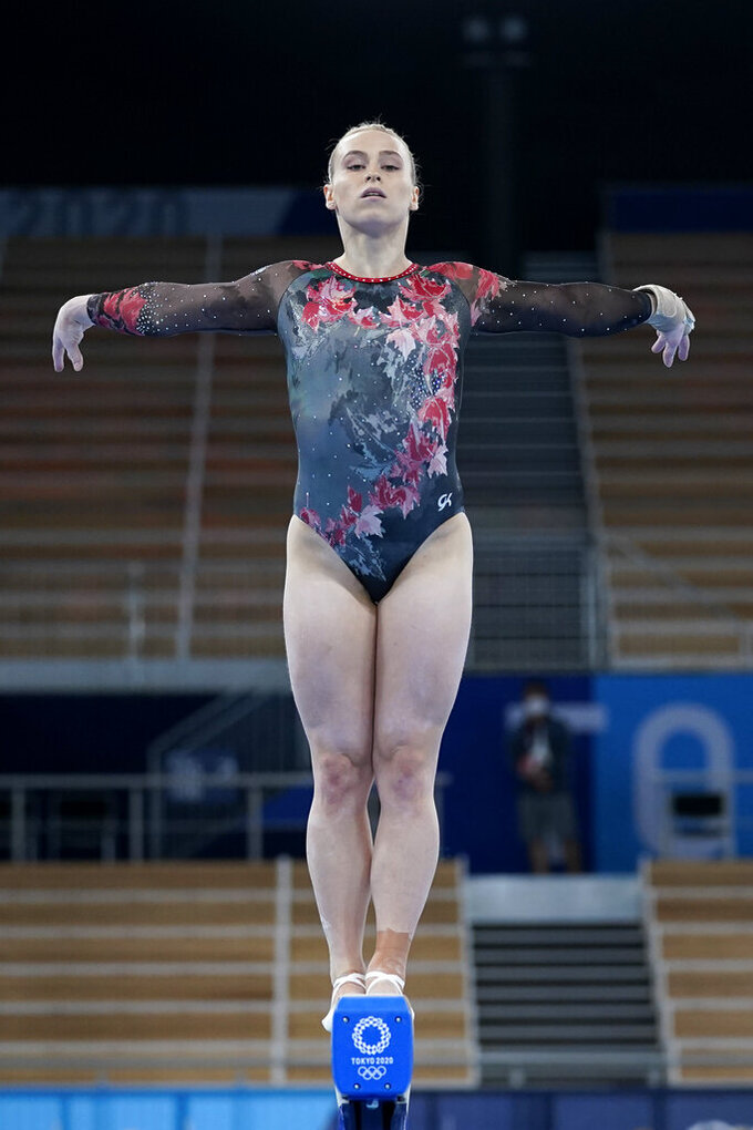 Elsabeth Black, of Canada, performs on the balance beam during the women's artistic gymnastic qualifications at the 2020 Summer Olympics, Sunday, July 25, 2021, in Tokyo. (AP Photo/Ashley Landis)