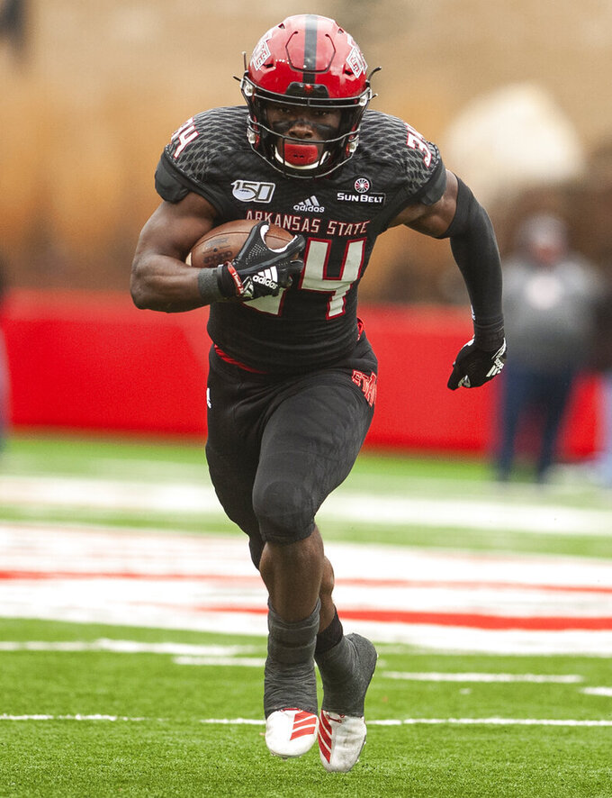 Arkansas State running back Marcel Murray carries the ball against Georgia Southern  during an NCAA college football game, Saturday, Nov. 23, 2019, at Centennial Bank Stadium in Jonesboro, Ark. (Quentin Winstine/The Jonesboro Sun via AP)