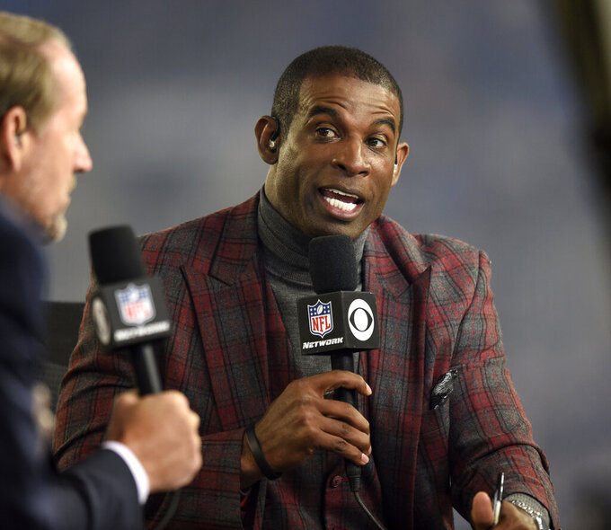 "FILE - In this Oct. 26, 2017, file photo, Deion Sanders speaks on the Thursday Night Football set during halftime in an NFL football game between the Baltimore Ravens and the Miami Dolphins, in Baltimore. The NFL launched a casting call Sunday, Nov. 17, 2019, looking for the next generation of youth football stars to help usher in its second century. In a spot launching ""The Next 100 Super Bowl Contest,"" Sanders calls for parents and youth coaches to send in videos showcasing their kids' best moves and highlighting their passion for America's most popular sport. Boys and girls ages 9-12 will get a chance to attend Super Bowl 54 in Miami and to appear in a follow-up commercial to last year's epic star-studded banquet spot that kicked off the league's 100th season.  (AP Photo/Gail Burton, File)"