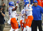 Boise State quarterback Brett Rypien, right, congratulates wide receiver John Hightower after Hightower's pass catch for a touchdown against Air Force in the first half of an NCAA college football game Saturday, Oct. 27, 2018, at Air Force Academy, Colo. (AP Photo/David Zalubowski)