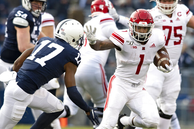 Rutgers running back Isaih Pacheco prepares to stiff arm Penn State safety Garrett Taylor (17) in the first quarter of an NCAA college football game in State College, Pa., on Saturday, Nov. 30, 2019. (AP Photo/Barry Reeger)