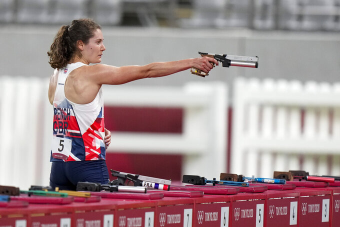 Kate French of Great Britain shoots during the final lap of the running and shooting portion of the women's modern pentathlon at the 2020 Summer Olympics, Friday, Aug. 6, 2021, in Tokyo, Japan. (AP Photo/Andrew Medichini)