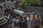 Relatives and neighbors carry the coffin of civilian Bashir Ahmed Khan during his funeral on the outskirts of Srinagar, Indian controlled Kashmir, Wednesday, July 1, 2020. Suspected rebels attacked paramilitary soldiers in the Indian portion of Kashmir, killing Khan and a paramilitary soldier, according to government sources. The family refutes the claim. (AP Photo/ Dar Yasin)