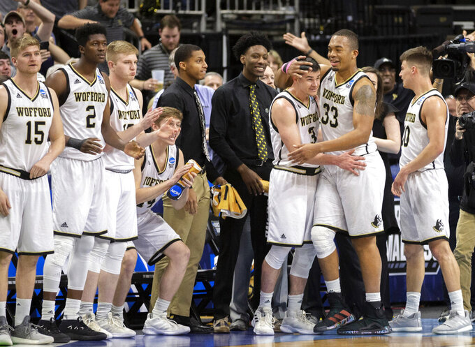 Wofford players celebrate during the final moments against Seton Hall in a first-round game in the NCAA men's college basketball tournament in Jacksonville, Fla. Thursday, March 21, 2019. (AP Photo/Stephen B. Morton)