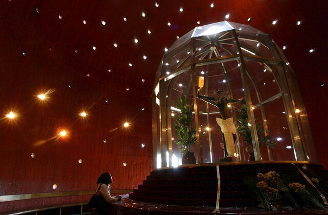 FILE - In this Feb. 25, 2005 file photo, a woman prays in front of Sangre de Cristo in the Metropolitan Cathedral in Managua, Nicaragua. The Vatican's top diplomatic envoy in Nicaragua said Monday, August 3, 2020, that he had requested the Nicaraguan government ensure a