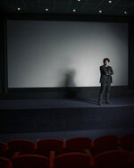 This Oct. 8, 2019 photo shows filmmaker Bong Joon-Ho posing for a portrait at the Whitby Hotel screening room in New York to promote his film