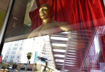 A fake Oscar statue is pictured in the window of a gift shop on Hollywood Blvd., Thursday, April 15, 2021, in Los Angeles. The 93rd Academy Awards will be held in various locations including the Dolby Theatre in Hollywood on Sunday, April 25. (AP Photo/Chris Pizzello)