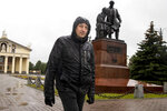 "In this photo taken on Sunday, June 28, 2020, Nikolay Nemytov, a 43-year-old worker at Russian Railways, walks past a monument to local inventors and engineers after his interview with The Associated Press in Nizhny Tagil, Russia. Workers in the city 1,400 kilometers (870 miles) east of Moscow that once was seen as a Putin stronghold are speaking out against the constitutional reforms that would allow him to stay in office until 2036. They are frustrated over dire living conditions that have not improved during his tenure. ""I am against the constitutional changes, most importantly because they are a coronation of the czar, who reigns but does not rule — Vladimir Vladimirovich Putin,"" says Nemytov. He says his monthly salary, the equivalent of $430, is not nearly enough. (AP Photo/Anton Basanayev)"