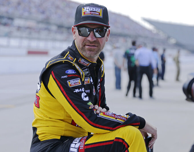 Clint Bowyer waits on pit road for his turn to qualify for the NASCAR Cup Series auto race on Saturday, Aug. 31, 2019, at Darlington Raceway in Darlington, S.C.. (AP Photo/Terry Renna)