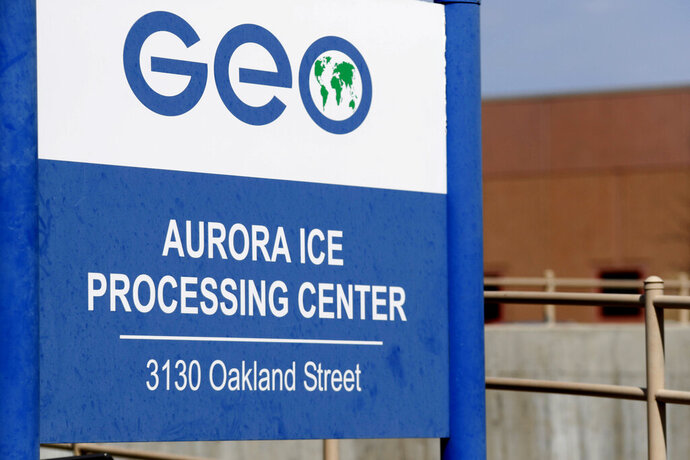 FILE - This April 15, 2017, file photo, shows the entrance to the GEO Group's immigrant detention facility in Aurora, Colo. U.S. immigration authorities say more than 2,200 people exposed to a mumps outbreak in at least two detention facilities have been quarantined. Immigration and Customs Enforcement said Tuesday, March 12, 2019, that the quarantine began March 7 at facilities in Pine Prairie, Louisiana, and Aurora, Colorado. (AP Photo/David Zalubowski, File)