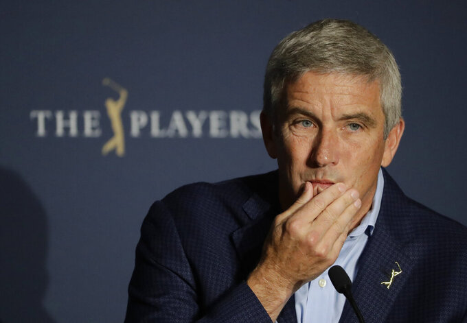 FILE - In this March 13, 2020, file photo, PGA Tour Commission Jay Monahan is shown during a news conference in Ponte Vedra Beach, Fla. Monahan decided against a public statement on the civil unrest sparked by the police killing of George Floyd, instead sending a letter to players. (AP Photo/Chris O'Meara, File)