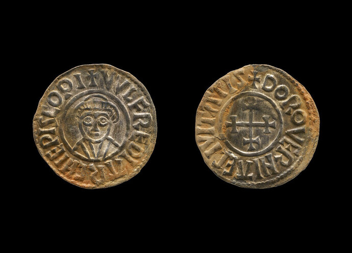 This undated handout photo provided by the British Museum shows a coin which was part of a £3 million Viking hoard, metal detectorists George Powell and Layton Davies have been convicted of stealing. Two amateur British treasure-hunters have on Friday, Nov. 22, 2019 been imprisoned for stealing a hoard of 1,100-year-old Anglo-Saxon coins and jewelry valued at millions of pounds. Experts say the hoard, much of which is still missing, could shed new light on a period when Saxons were battling Vikings for control of England. (British Museum via AP)