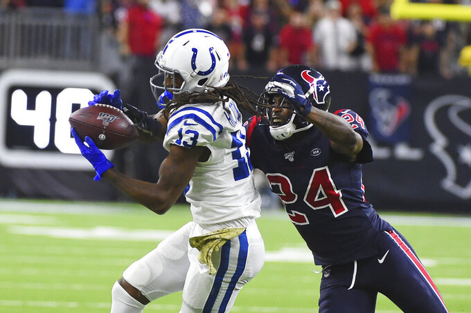 FILE - Indianapolis Colts wide receiver T.Y. Hilton (13) makes a catch in front of Houston Texans cornerback Johnathan Joseph (24) during the second half of an NFL football game in Houston, in this Thursday, Nov. 21, 2019, file photo. Colts receiver T.Y. Hilton was back on the practice field for Wednesday's, Oct. 13, 2021, light workout. The four-time Pro Bowler has been designated for return from injured reserve after having neck surgery in August and coach Frank Reich is optimistic Hilton will be cleared to play this weekend against the Houston Texans. (AP Photo/Eric Christian Smith, File)