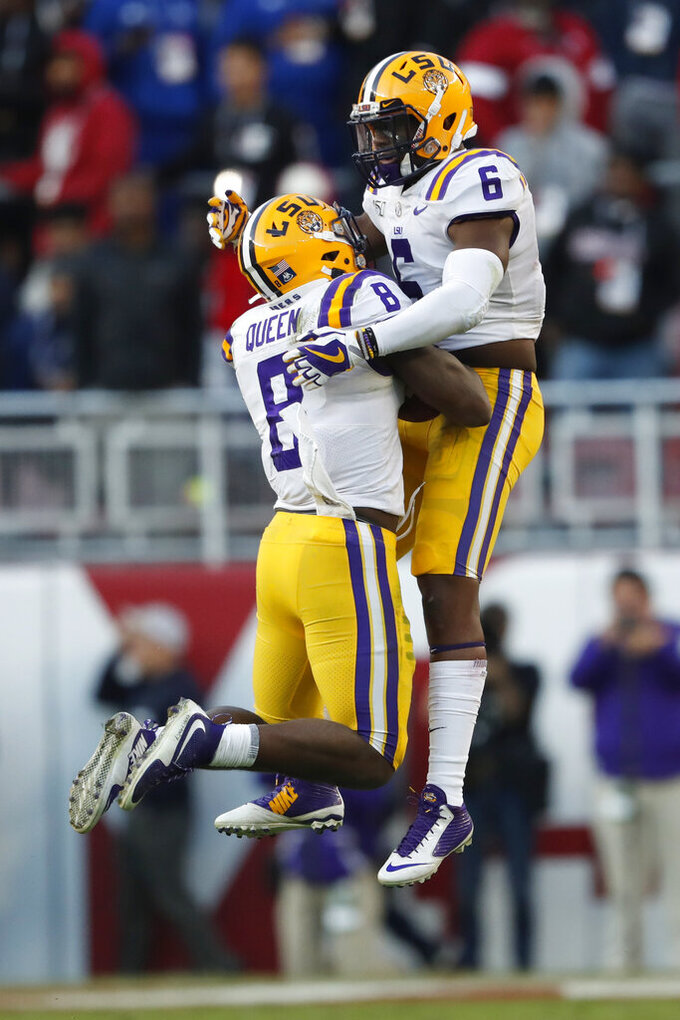 LSU linebacker Patrick Queen (8) celebrates with Jacob Phillips (6) after intercepting a pass in the first half of an NCAA college football game against Alabama, Saturday, Nov. 9, 2019, in Tuscaloosa, Ala. LSU won 46-41. (AP Photo/John Bazemore)