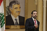 Lebanese Prime Minister Saad Hariri speaks during an address to the nation in Beirut, Lebanon, Tuesday, Oct. 29, 2019. Lebanon's embattled prime minister says he is presenting his resignation to the president after he hit a