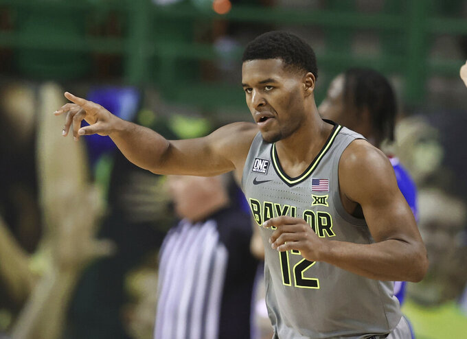 Baylor guard Jared Butler reacts to this three-point play against Kansas in the first half of an NCAA college basketball game, Monday, Jan. 18, 2021, in Waco, Texas. (Rod Aydelotte/Waco Tribune Herald via AP)