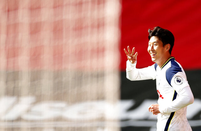 Tottenham's Son Heung-min celebrates after scoring his side's fourth goal during the English Premier League soccer match between Southampton and Tottenham Hotspur at St. Mary's Stadium in Southampton, England, Sunday, Sept. 20, 2020. (Andrew Boyers/Pool via AP)