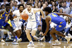 North Carolina guard Andrew Platek (3) dribbles against Pittsburgh guard Gerald Drumgoole Jr. (4) during the first half of an NCAA college basketball game in Chapel Hill, N.C., Wednesday, Jan. 8, 2020. (AP Photo/Gerry Broome)