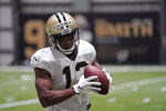 New Orleans Saints wide receiver Michael Thomas (13) goes through drills during practice at their NFL football training facility in Metairie, La., Monday, Aug. 24, 2020. (AP Photo/Gerald Herbert, Pool)