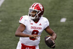 FILE - Indiana quarterback Michael Penix Jr. plays against Ohio State during an NCAA college football game in Columbus, Ohio, in this Saturday, Nov. 21, 2020, file photo. Penix watched his teammates finish the last three seasons without him. On Saturday, Sept., 4, 2021, he's expected to return to the field after a second knee surgery when the 17th-ranked Hoosiers open the season at Iowa.(AP Photo/Jay LaPrete, File)