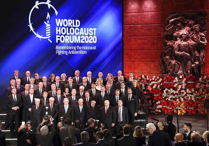 World leaders pose for a family photo during the World Holocaust Forum in Jerusalem, Thursday, Jan. 23, 2020. U.S. Vice President Mike Pence, Russian President Vladimir Putin,  French President Emmanuel Macron, and the presidents of Germany, Italy and Austria were among the more than 40 dignitaries attending the World Holocaust Forum, which coincides with the 75th anniversary of the liberation of the Auschwitz death camp.  (Abir Sultan/Pool Photo via AP)