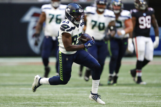 Seattle Seahawks wide receiver David Moore (83) runs against the Atlanta Falcons during the second half of an NFL football game, Sunday, Oct. 27, 2019, in Atlanta. (AP Photo/John Bazemore)