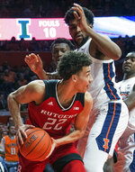 Rutgers guard Caleb McConnell (22) tries to get around Illinois center Adonis De La Rosa during the first half of an NCAA college basketball game in Champaign, Ill., Saturday, Feb. 9, 2019. (AP Photo/Robin Scholz)