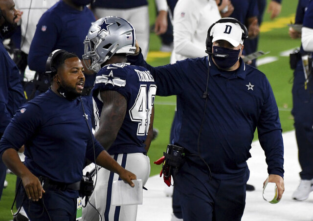 Dallas Cowboys head coach Mike McCarthy, right, is seen on the sideline against the Los Angeles Rams in the second half of an NFL football game, Sunday, Sept. 13, 2020, in Inglewood, Calif. (Keith Birmingham/The Orange County Register via AP)