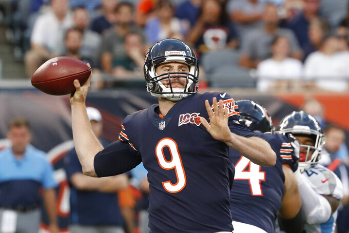 Chicago Bears quarterback Tyler Bray (9) throws during the first half of the team's NFL preseason football game against the Tennessee Titans, Thursday, Aug. 29, 2019, in Chicago. (AP Photo/Charles Rex Arbogast)