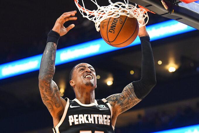 Atlanta Hawks forward John Collins dunks against the Detroit Pistons during the first half of an NBA basketball game Saturday, Jan. 18, 2020, in Atlanta. (AP Photo/John Amis)