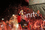 Tyler Reddick celebrates in Victory Lane after winning the NASCAR Xfinity Series auto racing championship on Saturday, Nov. 16, 2019, at Homestead-Miami Speedway in Homestead, Fla. (AP Photo/Terry Renna)