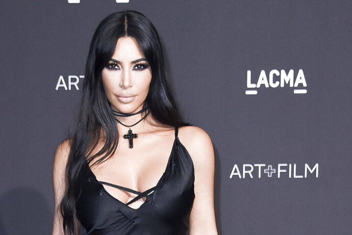 FILE - In this Nov. 3, 2018, file photo, Kim Kardashian West attends the 2018 LACMA Art+Film Gala at Los Angeles County Museum of Art in Los Angeles. The reality star and makeup mogul has decided to change the name of her Kimono Solutionwear less than a week after she received backlash from people who objected to what they said was appropriation of the traditional Japanese kimono in the name of her upcoming shapewear line. (Photo by Richard Shotwell/Invision/AP, File)